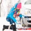 Winter car tire snow chains woman — Stock Photo #13814358