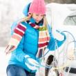 Winter car tire snow chains woman - Stock Photo