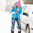 Woman having problems with car snow chains — Stock Photo #13814363