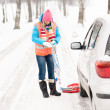 Woman holding car chains winter tire snow — Stock Photo #13814366