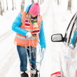 Woman holding car chains winter tire snow — Stock Photo