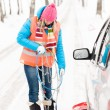 Woman holding car chains winter tire snow — Stock Photo #13814369