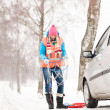 Stock Photo: Womholding car chains winter tire snow