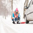 Woman with tire chains car snow breakdown — Stock Photo #13814371