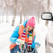 Womwith tire chains car snow breakdown — Stock Photo #13814372