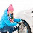Snow tire chains winter car woman trouble — Stock Photo
