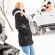 Woman having trouble with car snow assistance - Stock Photo
