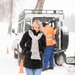Mechanic helping woman with broken car snow — Stock Photo
