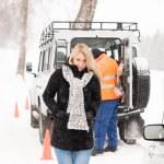 Mechanic helping woman with broken car snow — Stock Photo