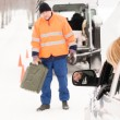 Woman broken car man gas can snow — Stockfoto