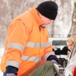 Man filling woman car gas winter assistance - ストック写真