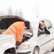 Man repairing woman's car snow assistance winter — Stock Photo #13814434