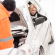 Man repairing woman's car snow assistance winter — Stockfoto