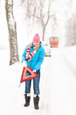 Woman with reflector triangle car snow breakdown — Stock Photo