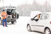 Winter car assistance man help woman breakdown — Stock Photo