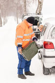 Man filling woman car gas winter assistance — Stok fotoğraf