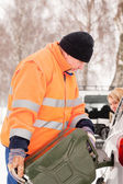 Man filling woman car gas winter assistance — Stock Photo