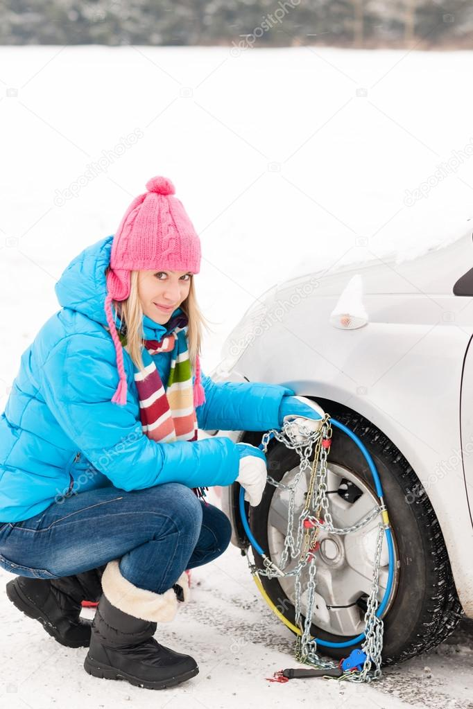 Snow tire chains winter car woman in trouble breakdown — Stock Photo #13814385