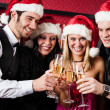 Christmas party friends at bar toast champagne — Stock fotografie