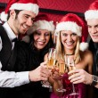 Christmas party friends at bar toast champagne — Stockfoto