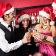 Christmas party friends at bar toast champagne — Stock Photo
