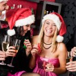 Foto Stock: Christmas party friends have fun at bar