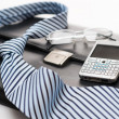 Business mens&#039; accessories tie briefcase phone - Stock Photo