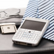 Business mens' accessories tie briefcase phone - Stock Photo