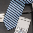 Stock Photo: Business accessories tie phone leather briefcase