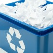 Blue recycling bin box with paper waste — Stock Photo