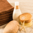 Spa beauty treatment products on sand - Stock Photo