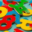 Colored wooden numbers and letters for children — Stockfoto