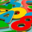 Colored wooden numbers and letters for children — Stock Photo