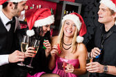 Christmas party friends have fun at bar — Stock Photo