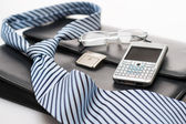 Business mens' accessories tie briefcase phone — Stock Photo