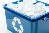 Blue recycling bin box with paper waste — Stok fotoğraf