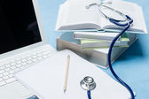 Medical research stethoscope lying on doctor book — Stock Photo