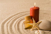 Spa setting candle with oil seashell star — Stock Photo