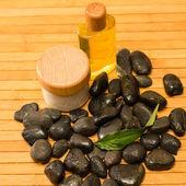 Spa zen stones with salt and oil — Stock Photo