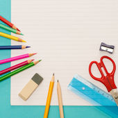 Back to school notepad with supplies — Stock Photo