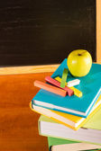 Back to school books and apple — Stock Photo