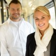 Woman and man smiling standing in train - Stock Photo
