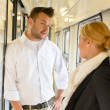 Woman and man talking on train hall - Stock Photo