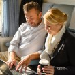 Woman and man relaxing in train laptop — Stock Photo #17417175