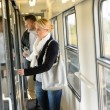 Woman opening the  door of train compartment - ストック写真