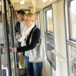 Woman opening the  door of train compartment - Stock Photo