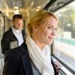 Woman in train looking pensive on window — Stock Photo