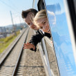 Stock Photo: Woman man heads out the train window