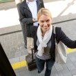Woman getting on the train man smiling — Stock Photo