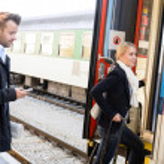 Woman getting on train man texting phone — Stock Photo #17417267